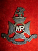 M53, The Wellington Rifles Browned Brass  Officer's Cap Badge