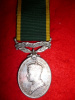 "Efficiency Medal, George VI with ""Canada"" scroll to a an RSM, Victoria Rifles"