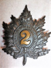 MM29 - 2nd Queen's Own Rifles Blackened Brass Busby Badge
